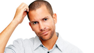 man puzzled over which device to choose